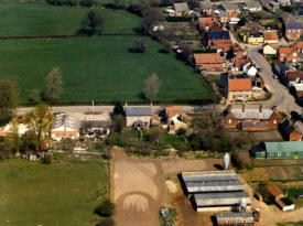 Aerial view of Castle Hill Road, pig farm and old village hall